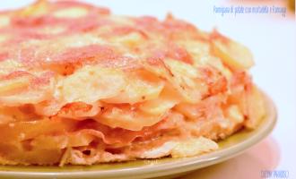 Parmigiana di patate con mortadella e formaggi